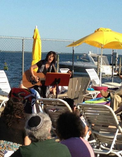 Sing a long with Musical Minds Sara Shonfeld at Pre-Shabbat service by the pool for Merrick Jewish Center NY